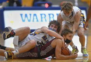 Junior Ryan Panek battles for loose ball in Warren's 58-55 loss to Zion